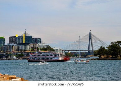 SYDNEY, NSW, AUSTRALIA - OCTOBER 28: Nostalgic paddle steamer and boats in Cockle Bay with Anzac bridge in background, on October 28, 2017 in Sydney, Australia