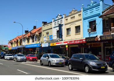 SYDNEY, NSW, AUSTRALIA - OCTOBER 31: Colorful facade of old buildings, shops and cars in Bondi district, on October 31, 2017 in Sydney, Australia