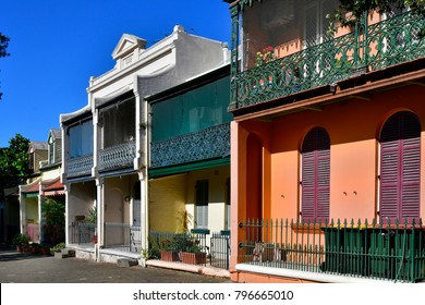 Sydney, NSW, Australia - October 31, 2017: Colorful homes in old structure from 19th century with balconies from wrought iron in Wooloomooloo district