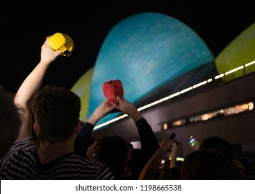 Sydney, NSW, Australia - October 9th 2018: Protesters at the 'Defend the Sydney Opera House' Rally with signs and torches to protest the Horse racing advertisements on the Sails of the Opera House.