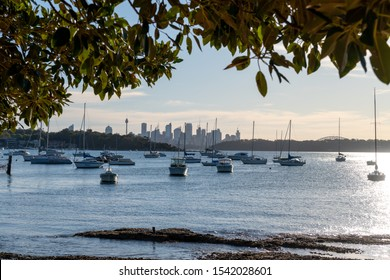 Sydney, NSW, Australia-Oct 20, 2019: View over the CBD skyline and boats from Watsons Bay, Australia's oldest fishing village and a popular spot with splendid views, delightful park and fresh seafood