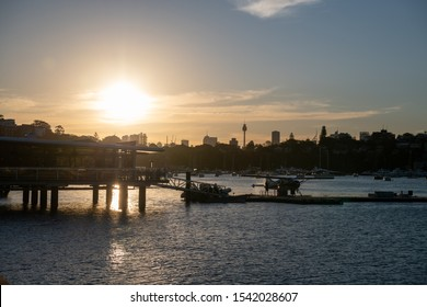 Sydney, NSW, Australia-Oct 20, 2019: View over Sydney Planes Rose Bay Terminal and seaplanes with sunset in background in Rose Bay, Australia