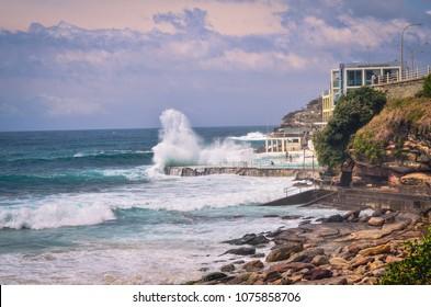 Sydney, NSW/Australia - 6th November 2017: Huge waves crashing into public swimming pool at Bondi beach