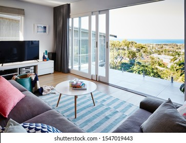 Sydney, NSW/Australia-July 14 2017: interior photography of modern lounge room with view to ocean in background