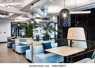 Sydney, NSW/Australia-July 14 2018:Interior photography of a contemporary designer office breakout area with booths, pendant lighting and polished concrete floors