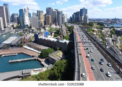 SYDNEY - OCT 18 2016:Sydney skyline with the Southern approach of the Sydney Harbour Bridge with The Rocks to the left in Sydney, Australia.