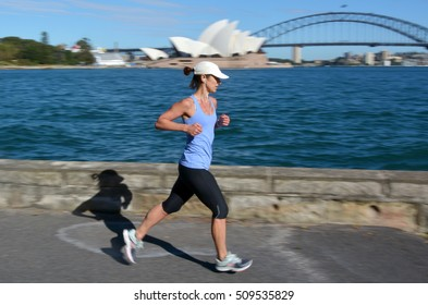 SYDNEY - OCT 19 2016:Australian woman runs along Sydney Harbour. Approximately 35% of the Australian population participated at least in one physical recreation activity.