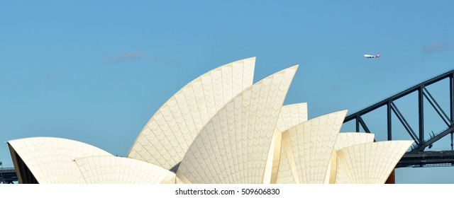SYDNEY - OCT 19 2016:Jetliner plane fly above Sydney Harbor Bridge and Sydney Opera House in Sydney, New South Wales, Australia.