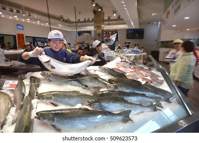 SYDNEY - OCT 20 2016:Vendor sale seafood in Sydney Fish Market, a Large marketplace  and a major tourist attraction featuring shops for seafood, deli items and restaurants.