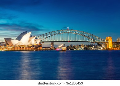 SYDNEY - OCTOBER 16, 2015: Night view of Sydney Harbour. More tha 15 million people visit Sydney annually.