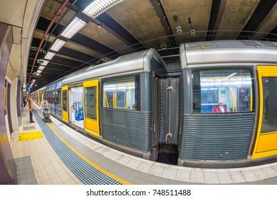 SYDNEY - OCTOBER 2015: Sydney subway train arrives at station. Sydney Trains is the suburban passenger rail network serving the city .