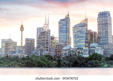 SYDNEY - OCTOBER 23, 2015: Beautiful panoramic view of city skyline at dusk. Sydney attracts 10 million visitors around the globe annually.