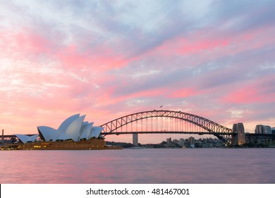 Sydney Opera House and Harbour Bridge at sunset. Sep,11,2016.The Sydney Opera House,Sydney,NSW,Australia.It was designed by Danish architect Jorn Utzon, finally opening in 1973.