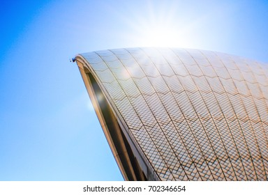 Sydney Opera House, roof texture with blue sky and bright sun light flair on background