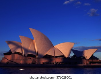 Sydney Opera House at Sunset, with the shadow of the Sydney Harbour Bridge imposed on its iconic sails. Sydney, New South Wales, Australia