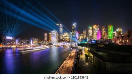 Sydney Panorama at East Circular Quay during the Vivid Sydney Festival 2018. Vast play of light from Harbour Bridge to Circular Quay incorporates interactive lighting full color laser show.