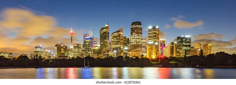 Sydney Skyline, Sydney Landmark, Sydney Tower and Sydney City CBD at night with blue sky blur cloud long exposure and Reflection From circular quay from Mrs Macquarie's Chair in Summer, Australia