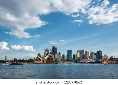 Sydney Skyline, NSW, Australia - September 28, 2018: View of Sydney CBD and the Opera House on a beautiful sunny day from across the bay at the old Kirribilli wharf.