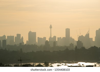 Sydney skyline silhouette under the hazy summer sunlight.