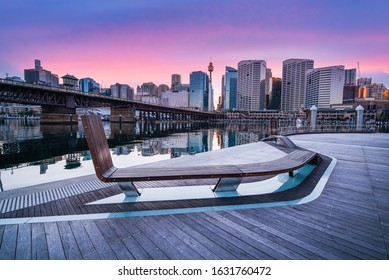 Sydney Tower Eye, View of Sydney skyline from Darling Harbour Bridge with colourful sunrise sky morning, New south wales,  Australia