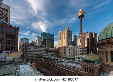 Sydney two famous landmarks - Queen Victoria Building and Sydney Tower during the evening with bright light and blue sky with some high clouds