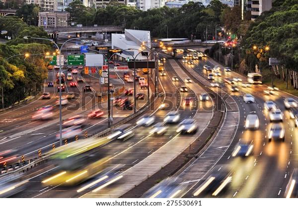 Sydney warringah freeway rush hour traffic with blurred head lights at sunset