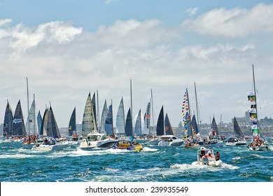 SYDNEY,AUSTRALIA - DECEMBER 26,2014: Motor boats follow yachts competing in the 70th Sydney to Hobart yacht race. It is one of the world's greatest yacht races.
