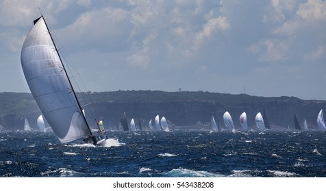 """SYDNEY,AUSTRALIA - DECEMBER 26,2016: Yachts race down the coast in the annual Sydney to Hobart yacht race. The """"great race"""" is hugely popular with Sydneysiders."""