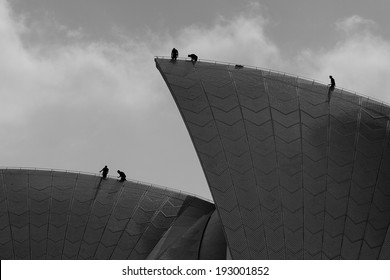 SYDNEY,AUSTRALIA - DECEMBER 29, 2013: Technicians place fireworks on the Opera House. It was included in the NYE celebrations for the first time in 10 years.