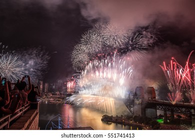 Sydney,Australia - December 31,2016: People watch the New Year's Eve fireworks from rooftops and parks.