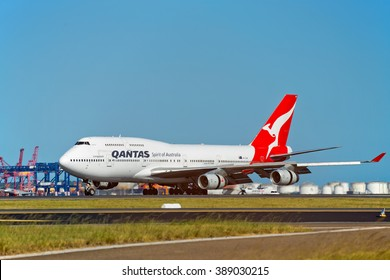 SYDNEY,AUSTRALIA - FEBRUARY 28,2016: A QANTAS Boeing 747-400 lands at the city's airport on an international flight.