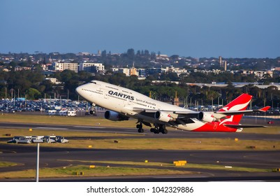 SYDNEY,AUSTRALIA - JANUARY 20,2018: A QANTAS Boeing 747 leaves the airport on an international flight.