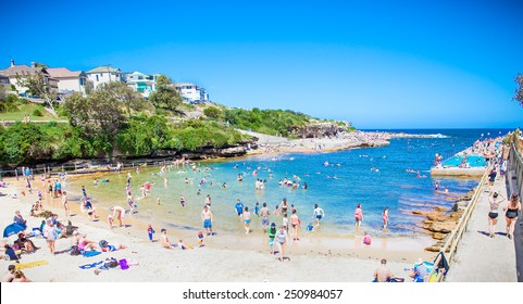 SYDNEY,AUSTRALIA-DEC 30, 2014:People relaxing at Clovelly sendy beach in Sydney, Australia on Dec 30, 2014.Clovelly Beach's natural rock pool has a reputation among Sydneysiders as the best snorkeling