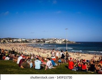 SYDNEY-DECEMBER 25:People relaxing for christmas day at  Bondi beach in  Sydney,Australia on 25 December 2012 .Bondi beach is one of a famous beach in the world.
