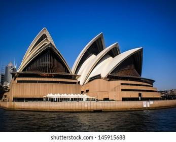 SYDNEY-SEPTEMBER 22 : Sydney opera house with blue sky in  Sydney,Australia on 22 September 2012 .It was designed by Danish architect Jorn Utzon.