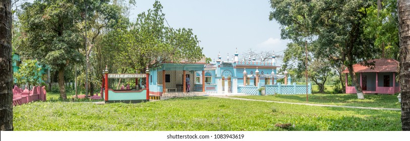 SYLHET, BANGLADESH - 9 APRIL, 2018: A panoramic view of an Islamic shrine for Muslim saints or mazar surrounded by mango trees.