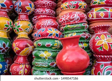 SYLHET, BANGLADESH - APRIL 09, 2018: Brightly colored pots and dishes stacked on the street at a market stall.