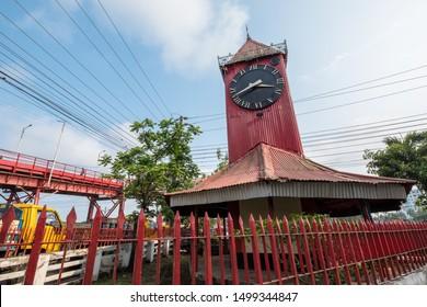 SYLHET, BANGLADESH - APRIL 11, 2018: Ali Amjad's Clock the British Empire era red clock tower, a popular tourist attraction in downtown Sylhet.