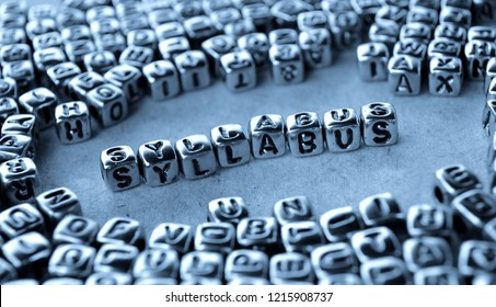 Syllabus - Word from Metal Blocks on Paper - Concept Photo on Table