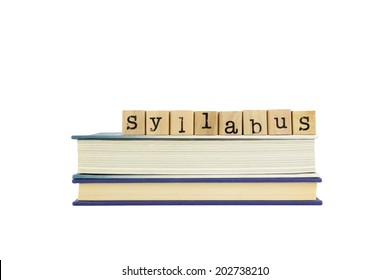 syllabus word on wood stamps stack on books, curriculum and training concept