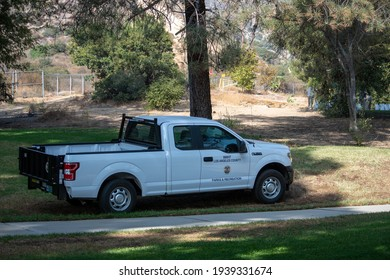 Sylmar, California, United States - October 21, 2020: Los Angeles County Parks and Recreation logo and seal on trucks at a construction project at Veterans Memorial Community Regional Park.