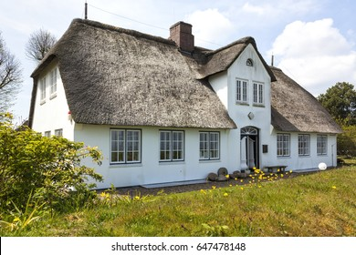 Sylt, Germany - May 11, 2017: Typical frisian thatched roof house containing the Local museum of Sylt at Keitum village