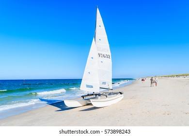 SYLT ISLAND, GERMANY - SEP 9, 2016: Sailing boat on Kampen beach, Sylt island, Germany.