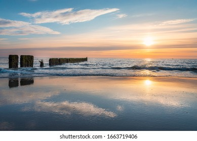 Sylt island sunset over North Sea water. Sylt island beach at sunset. North Sea beach twilight landscape. Horizon over sea.