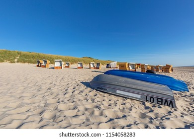 Sylt - View abandoned boats and Beach Chairs at Wenningstedt Beach, Schleswig-Holstein, Germany, Sylt, 06.06.2018