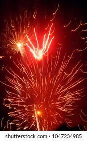 Sylvester, New Years Eve, red firework on dark black sky