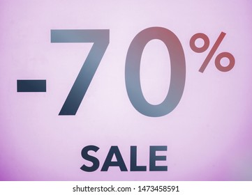The symbol is 70 percent, on a pink background. Seasonal discounts in stores, sale, Black Friday and shopping concept.