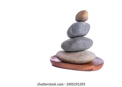 symbol of balancing nature. Balance of rock on isolated white