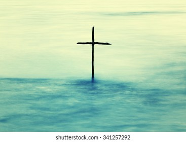 symbol of Baptism, a wooden cross in the Jordan River, instagram effect
