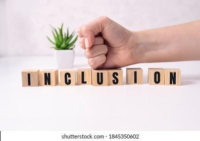 Symbol for a better inclusion. Wooden cubes with word 'inclusion'